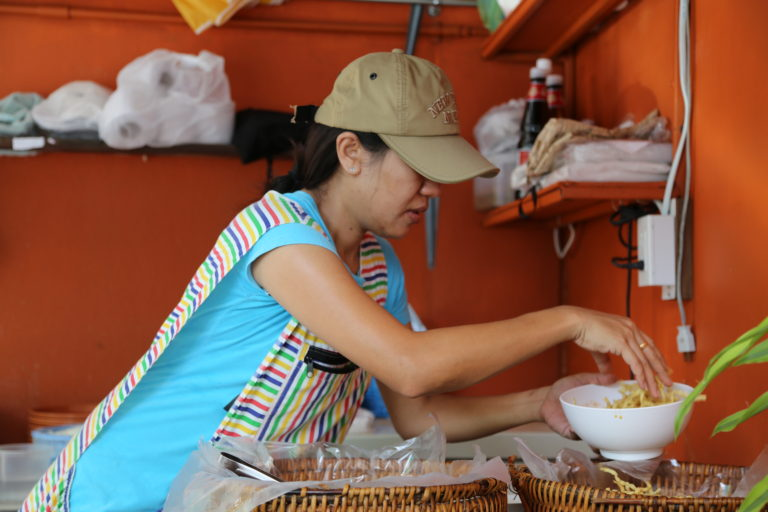 Preparing a bowl of Khao Soi (Source: Streetside Bangkok)